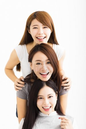 Photo for Closeup happy Young Women Faces Looking at Camera - Royalty Free Image