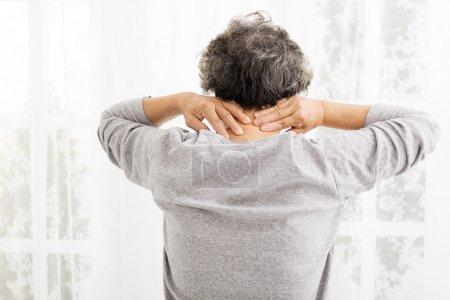 senior woman with neck pain