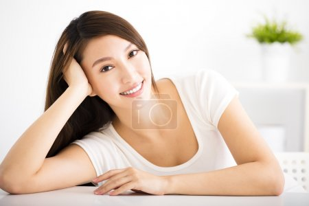 Relaxed young smiling woman  in living room...