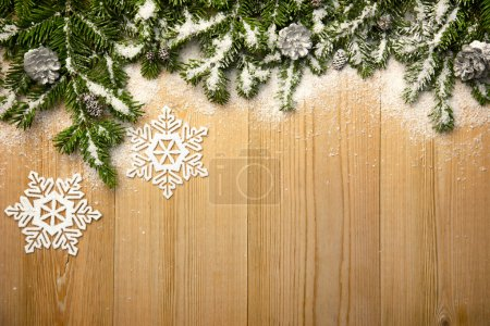 Christmas background with firtree, decorative snowlakes and cone