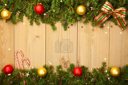 Christmas background with firtree, candies and baubles