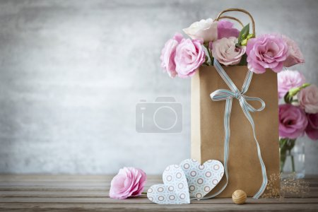 Photo for Valentines Day background with pink roses, bow and paper Hearts - Royalty Free Image