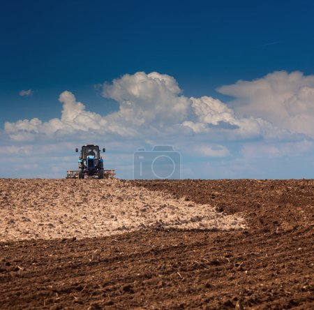 Agricultural Lanscape - Tractor working on the field