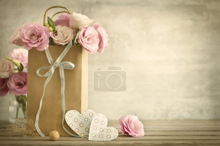 Wedding background with pink roses, bow and paper ...