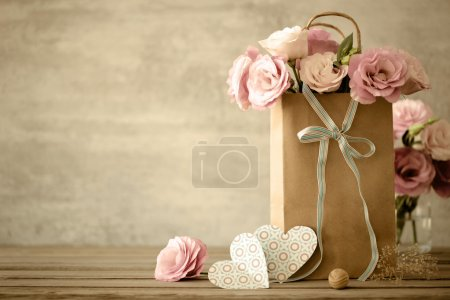 Photo for Love background with pink flowers, bow and paper handmade hearts, vintage toned - Royalty Free Image