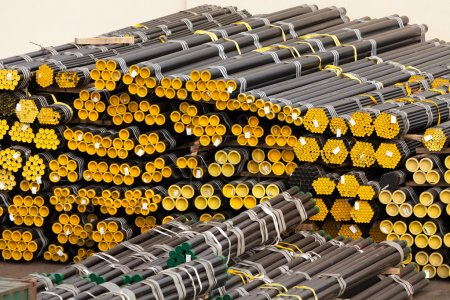 Photo for Pipes closeup stack in storage - Royalty Free Image