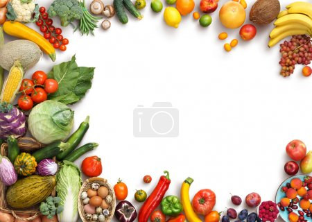 Foto de Organic food background. Food photography different fruits and vegetables isolated white background. Copy space. High resolution product - Imagen libre de derechos