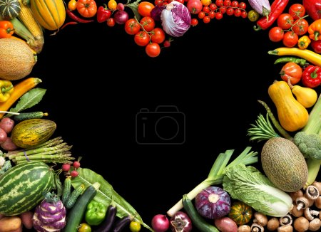 Foto de Deluxe Heart symbol. Food photography of heart made from different fruits and vegetables isolated black background. Copy space. High resolution product - Imagen libre de derechos