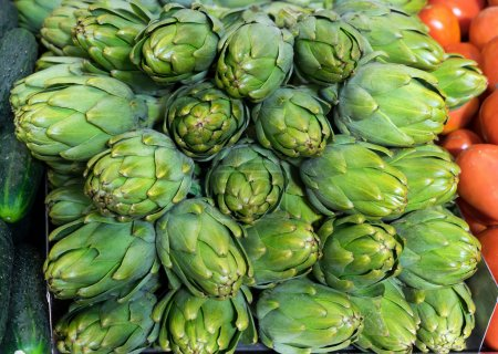 Fresh artichokes for sale at a farmers market