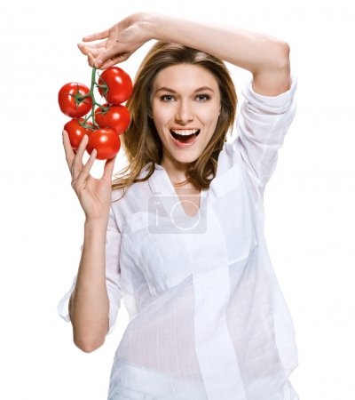 Healthy lifestyle woman holding a bunch of tomatoes in her hands, healthy food concept
