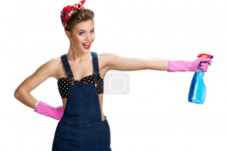 Pretty cleaning lady wearing pink rubber protective gloves holding spray