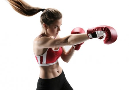 Boxer woman during boxing exercise making direct hit with red glove