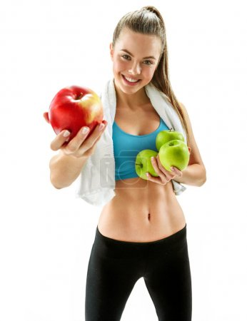 Cute smiling woman with red and green apples, sports trainer, organic food, health and beauty care concept