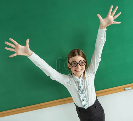 Humorous high angle view of Thrilled pupil raise her palms up