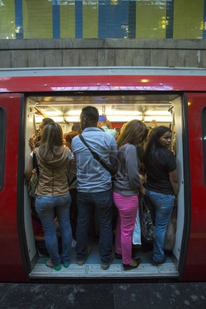 People standing in subway during rush hour, Caracas