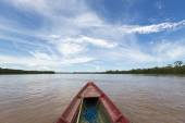 Journey on a wooden boat on Beni river near Rurrenabaque, blue s