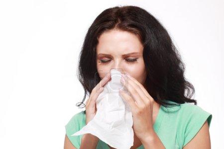 portrait of woman sneezing