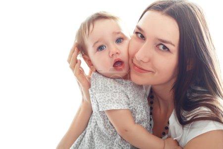 mother holds her little girl