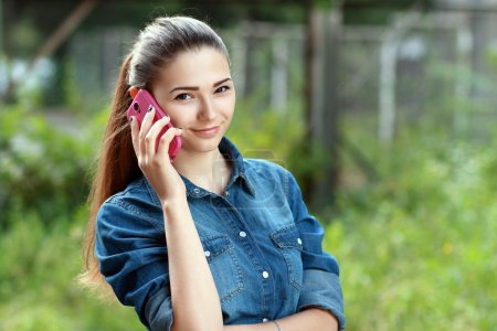 Young teen woman using mobile