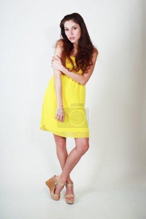fashion model in  yellow dress