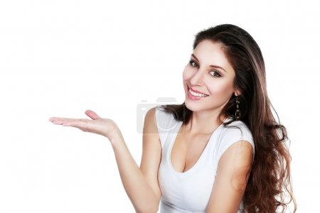 Photo for Beautiful young mixed latino, caucasian woman presenting your very exciting product. Isolated on white. - Royalty Free Image