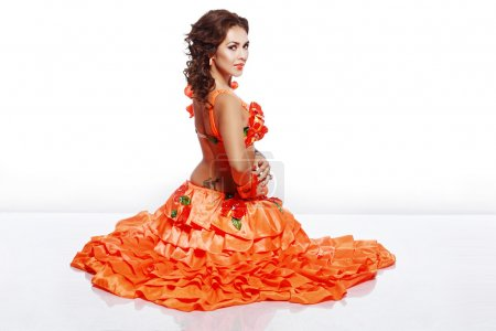Photo for Beautiful exotic girl with Hawaiian accessories dress sitting on the floor - Royalty Free Image