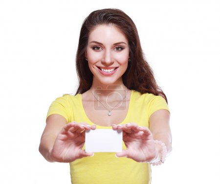woman holds business  card