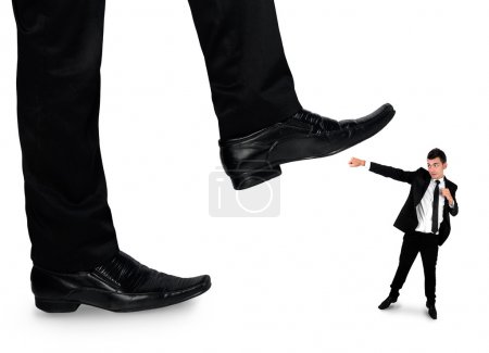 Feet man crushing little business man