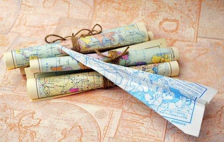 Photo pour Old rolled vintage maps and gift - image libre de droit