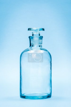 Empty clear reagent bottle with glass stopper