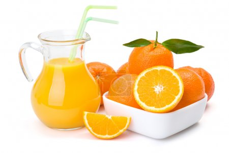 Photo for Ripe orange fruits and jug of fresh juice - Royalty Free Image