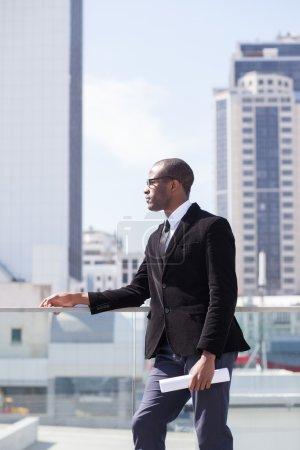 Estate agent portrait on skyscrapers background