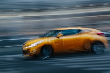 Yellow Sports Car in a Blurred City
