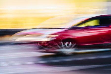 Red Sports Car in a Blurred City