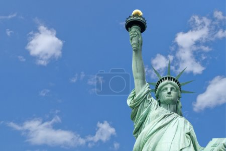The Liberty Statue with blue sky