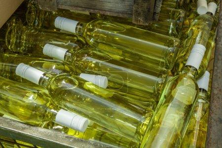 Storage box with white wine bottles