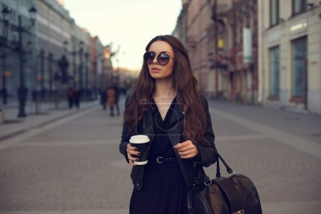 girl with coffee outdoors
