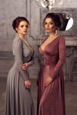 two ladies in dresses