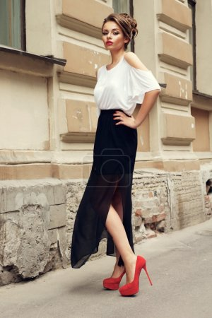 Photo for Outdoor portrait of you beautiful stylish girl wearing long black skirt and white t-shirt - Royalty Free Image