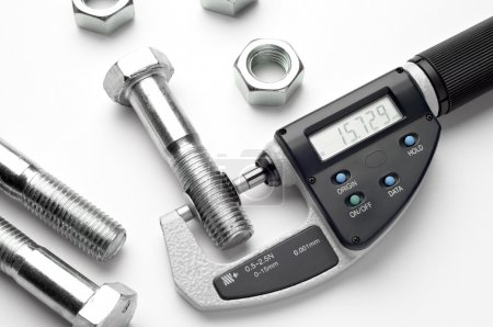 Digital micrometer with adjustable pressure measurement with steel screw.