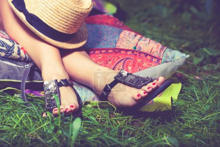 woman's  feet on grass