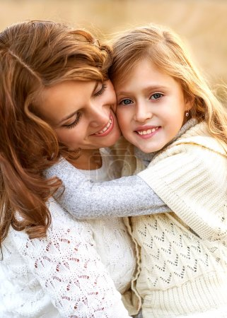 Photo for Young mother and her toddler girl have fun, mother's Day. - Royalty Free Image