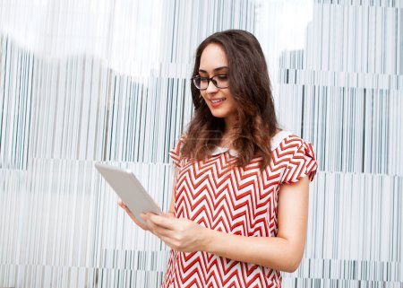 fashion girl holding a tablet PC on the business background