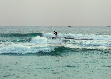Surfer at the sea