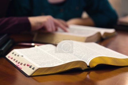 Photo for Young couple studying the Word of God together - Royalty Free Image