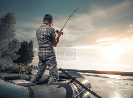 Mature man fishing on the lake