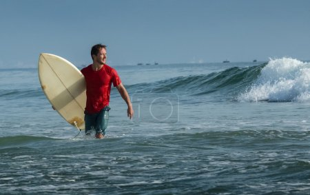 Happy surfer with short board