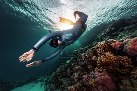 Free diver swimming underwater