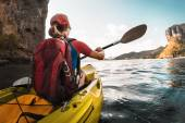 Woman paddling the sea kayak