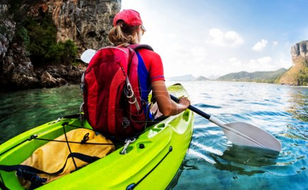 Woman paddling the sea kayak